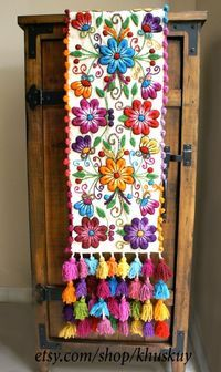 Peruvian Embroidered Table Runner Sheep wool runner hand embroidered with graceful flowers and leafs, finished with multicolored tassels. Each runner is a work of art. It takes several days to finish every unique piece, from the weaving of the fabric, the Hand Embroidery Designs, Embroidery Stitches, Embroidery Patterns, Special Gifts For Her, Mexican Embroidery, Wool Runners, Handmade Table, Bed Runner, Elegant Flowers