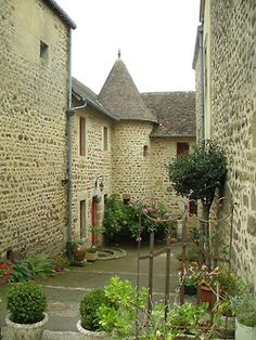 Medieval streets of Saint-Céneri-le-Gérei in Normandy, France (by couscouschocolat).