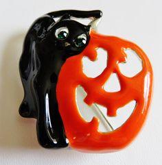Vintage AJC Halloween brooch of a black cat and orange jack 'o lantern.