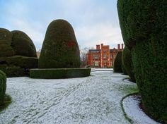 From our friends at York  @uniofyork - Peeking through the snowy topiary at Heslington Hall stay wrapped up and travel safely this weekend! #uniofyork #pretty #snow #heslingtonhall #wrapupwarm #goviewyou