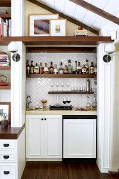 A little-used closet gets a new life as a wet bar accented with white Moroccan-style ceramic tile. | Photo: Joe Schmelzer | thisoldhouse.com