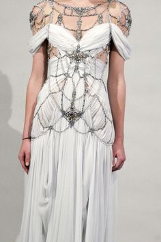 hmmm, not sure if I like this wedding dress or not. It's beautiful but a little S&M esque...what do you think?