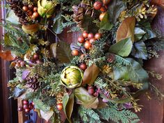 Keep It Natural  Combine magnolia leaves, berries and pine cones with unusual vegetables, like artichokes, for a nature-inspired Christmas wreath. Image courtesy of Kristalyn Naylor, the Gathering Place Design.