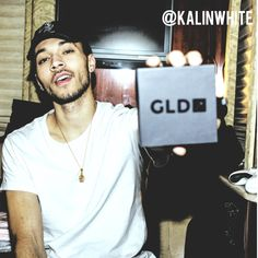 Kalin White reaping GLD Buddha and Free the Trap hat