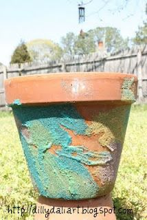 Cover terra cotta pots with colored sand