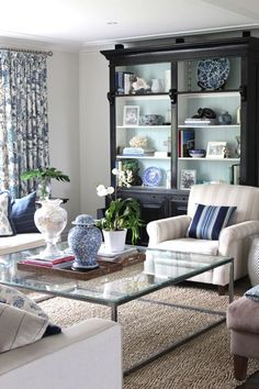 Like the light blue paint ~ or any light color paint~ on the inside of dark colored bookshelves to make them pop.