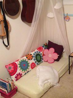 Playroom Book Nook. Using repurposed crib mattress and body pillow.