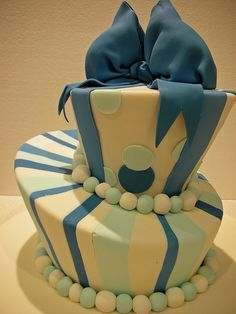 Topsy Turvy Blue and White Birthday cake by Belle's Patisserie
