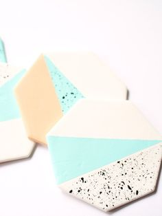 Geometric Polymer Clay Coasters painted with porcelain paint and sealed with a glossy, water-repellent finish for interior and table top decoration or as unique gift. ▲▲▲▲▲▲▲▲▲▲▲▲▲▲▲▲▲▲▲▲▲▲▲▲▲▲▲▲▲▲▲▲▲▲▲▲ WHAT YOU RECEIVE A set of 4 clay heptagon coasters measuring approximately 9 - 10 cm in diameter. The backside is covered with a off-white felt layer for ultimate protection. Additionally the felt backside is stamped with the brand logo. The coasters have a beautifully smooth and glossy…