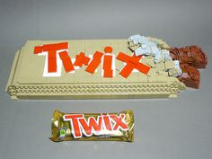 Is your candy bar not satisfying enough? Then get yourself a supersized Twix bar at your nearest Lego Candy Store. Lego Friends, Lego Food, Lego Candy, Lego Creative, Twix Bar, Lego Furniture, Lego Sculptures, Amazing Lego Creations, Lego Pictures