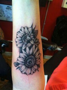 sunflower-tattoo-black-besides-grey