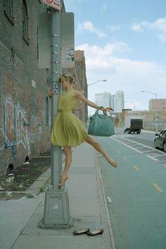 Ballerina in normal clothes ballet in street
