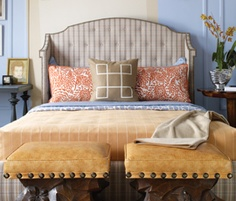 The headboard is like a massive wing back chair; designed by Jeffers Design Group.