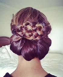 Braided updo with turkish knot motif.  Great bridal Party or mother of the bride wedding hairstyle.