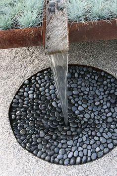 water feature - metal runner into circle of stones