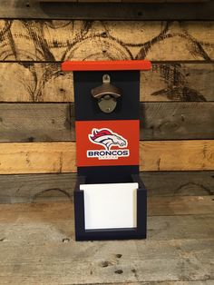 New England Patriots bottle opener with cap catch. Door slide is removable for easy emptying. Indoor use only. 13 h x 7 w x 4 Beer Caddy, Football Images, Denver Broncos, 4 H, New England Patriots, Wall Mount, Bottle Openers, Indoor, Fun Things