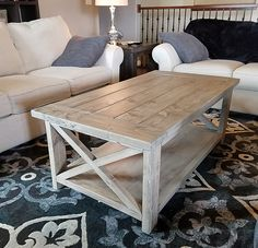 Rustic meets coastal chic with this beautiful solid wood coffee table finished in our exclusive weathered driftwood staining process and coated with a durable matte finish. This piece is versatile and will compliment a variety of color palettes. Measurements: 52 L x 27 1/2 W x 19 1/2 H We also offer 2 sizes of matching end tables for sale so please check our other available listings. Custom sizes and finishes are available. Please contact me and Id be happy to discuss other options. Shipp...