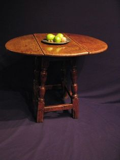 A SMALL CHARLES II OAK DROP LEAF JOINT STOOL TABLE. C1680.