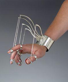 Bracelet 'Ornamental Hands' by Jennifer Crupi.  - Eerie but fascinating.