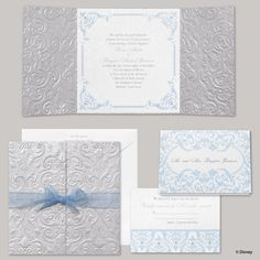 "Let your ""Happily Ever After"" wedding start with an invitation worthy of Cinderella's beauty and elegance! The square invitation of white shimmer paper has a flourish border of grey and blue to surround your wording, which is printed in your choice of up to two imprint colors and two lettering styles. An embossed silver shimmer wrap surrounds the invitation with princess-worthy beauty."