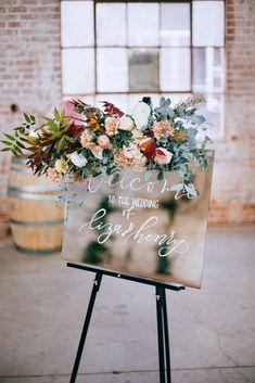 Beautiful Glass Wedding Sign + Flower Arrangement | Diamond Bridal Gallery