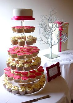 Like the wedding cake on top and the cupcakes... for easy serving!!!