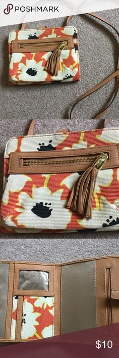 Small Cross body Purse! Cross-body thin strap opens with 5 pockets inside, id holder, and zip hassle deep pocket on the outside. Great color combos of orange, yellow, white, black, and tan. Has a snap the opens and lays flat. Would be great on vacation or when you don't want a big purse but just the essentials! My iPhone 6 fits in outside pocket without a case. :) I love the thin strap and the lightweight feel of this super cute purse! Bags Crossbody Bags