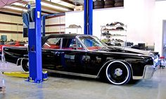 Black Lincoln at Elite Motorworks side