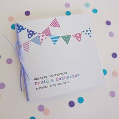 Create a stylish first impression for your wedding with our wonderful Bunting Wedding Stationery. This range can really add the a Wow! Wedding Invitations - There are 2 styles, a folded square invitation which has a printed insert sheet inside, with or without ribbon and a flat postcard style invitation printed on 1 side. Supplied with a white envelope. Save The Date Card - This is a post card style printed on 1 side. Supplied with a white envelope. RSVP Card - This is a flat square card…