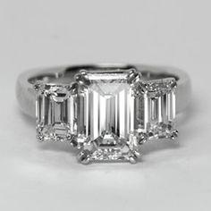 Three stone emerald cut diamond ring from Oliver Smith Jeweler.