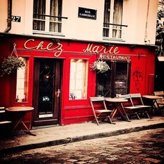 Photograph of a rustic Parisian cafe in Montmartre, Paris, France by Tracey Capone
