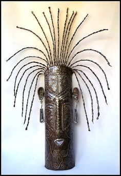 Haitian ethnic mask wall design has been hand cut from a flattened, recycled steel drum by a talented Haitian metal artist at our workshop in Haiti. - African Mask - Metal sculpture art mask measures