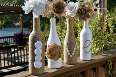 Twine wrapped wine bottles / Upcycled / featuring handmade roses spelling out 'Love'