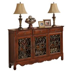 Console table with a scalloped apron and scrollwork door fronts.  Product: Console tableConstruction Material: Wood