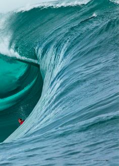 See the surfer. What a great photo and look at the color of that water.