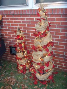 my fall trees made of tomato cages, burlap and vine. saw something like this at lowes in dunn but i didn't use berries, they were too high. so i found this vine with berries on it at ac more and it was 6.99 a 6 foot section, but on sale for 1.75..... cant beat that!!!!!