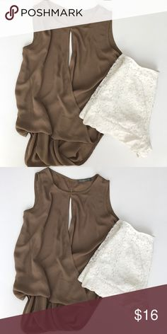 Finn & Clover Tank Top is brand-new and has never been worn. It has a slit in the front and an open slit in the back.  It is a size medium. Tops Tank Tops