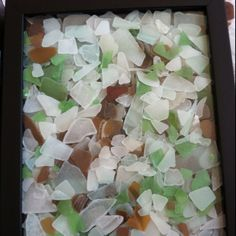 Shadow box frame with the sea glass Rich and I have collected.. I love the red piece in the center