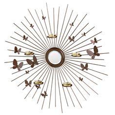 Perhoset-seinälampetti - VARAUSLAHJA KUTSUILLA P92075 Perhoset-seinälampetti Metallinen seinälampetti, jossa peili keskellä. Mukana viisi votiivilasia. Halkaisija 60 cm. Votiiveille ja Tuikkiville