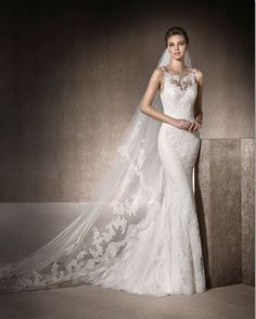 Maria- Fitted lace dress with train. Soft lace gives this dress a high neckline finished with diamante detailed straps leading to an open back