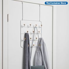 Imagine finding the right accessories instantly and getting out of the house in no time. Our over-the-door organizer from Umbra makes it happen, with a design that keeps everything sorted and easy to see. With 14 wooden-capped hooks, there's space for jewelry, scarves, wristlets, keys, lanyards and caps. Best of all, it can be installed quickly on a wall or door with included hardware. Over The Door Organizer, Over The Door Hooks, Hanging Closet Organizer, Purse Storage, Handbag Organization, Home Organization, Organizing, Door Rack, Door Hangers