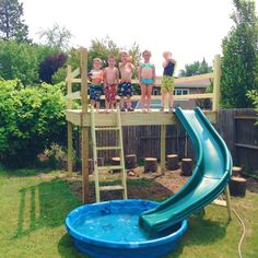 I like the wading pool at the end of the slide. DIY Kid's Play Platform and Jumping Stumps!