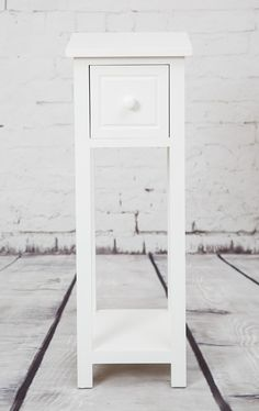 Designed with practicality in mind, this elegant pure white telephone table with drawer is a stylish solution for living rooms or hallways. Constructed from wood, this piece offers great quality and practicality in mind.