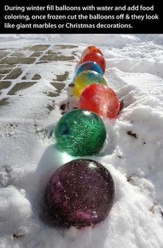 """Frozen water balloons with food coloring - cool decoration idea for the winter! And so much fun. Use any shape or size! (we even made a huge one with a """"punch ball"""" balloon. Cheap and easy fun! :)"""
