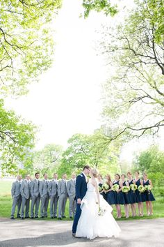 The couple chose a classic navy and gray color palette for their wedding party. The guys sported pale gray suits, while the girls wore short A-line dresses in navy.
