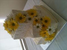 Yellow & white wedding cake with real daisies