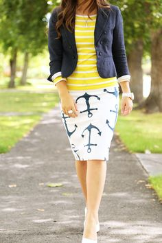White & navy anchor skirt, yellow & white l/s shirt, navy blazer, white heels.