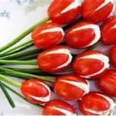 "This is a great recipe  found on gastrobasket,wordpress.com. Who said, ""This idea will definitely make you a popular party host! Simple but stylish party food in 30 minutes. Tasty and stylish tomato tulips!"" So adorable- had to share.  Photo by: biblisdmskow.pl"