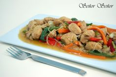 Chop suey is an Americanized Chinese dish that is popular for take-out, but it is actually quite simple to make at home. A mixture of vegetables, such as bell peppers, leeks, and bean sprouts, and chicken are dressed in a sweet and sour sauce. The sauce is thickened with cornstarch which helps it to coat each ingredient perfectly. Serve this stir-fry over rice for a filling and complete meal.