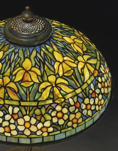 """Tiffany Studios """"DAFFODIL AND NARCISSUS"""" TABLE LAMP with an elaborate """"Water Lily Twisted Stem"""" base shade impressed TIFFANY STUDIOS NEW YORK 1917 base impressed TIFFANY STUDIOS/NEW YORK/S220/443 leaded glass and patinated bronze 28 3/8 in. (72.1 cm) high 20 1/8 in. (51.1 cm) diameter of shade circa 1905"""